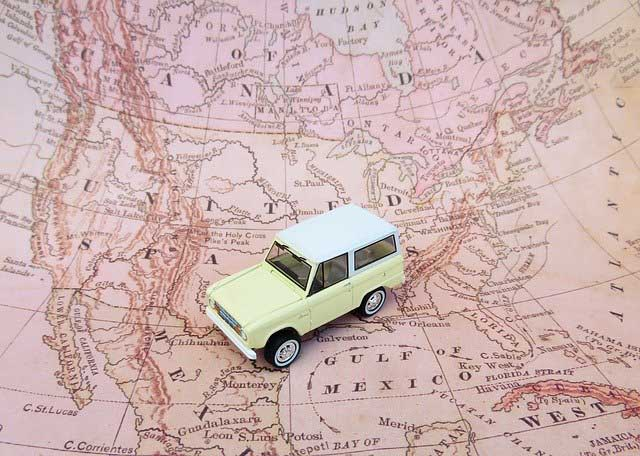 car on a north america map