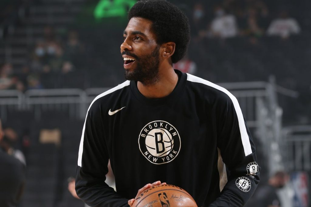 kyrie warming up